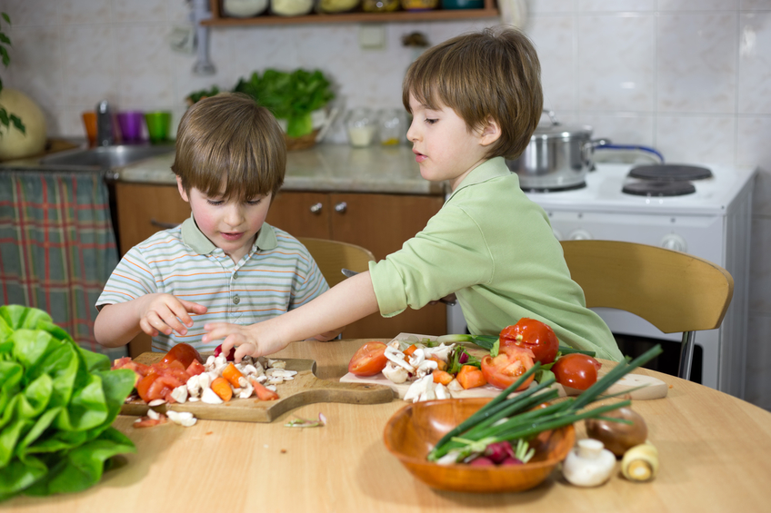 Boy Helping His Brother to Make Fresh Salad at Home