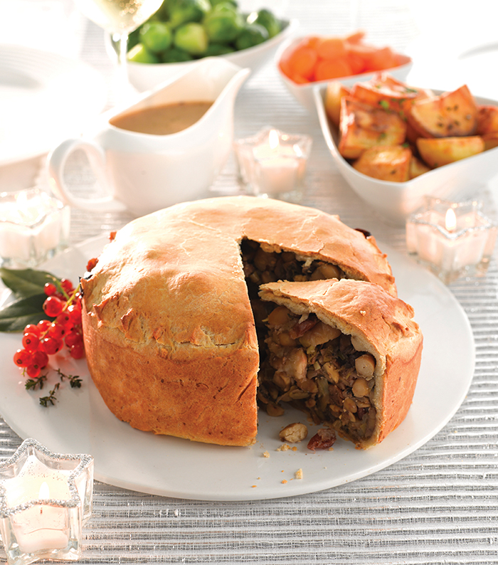 Looking for the perfect dish to take pride of place on your Christmas table this year? Well look no further than this sumptuous vegan Christmas pie that's stuffed with beans, cranberries, nuts and veggies!