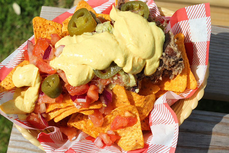 Loaded vegan nachos with cheese sauce and refried beans