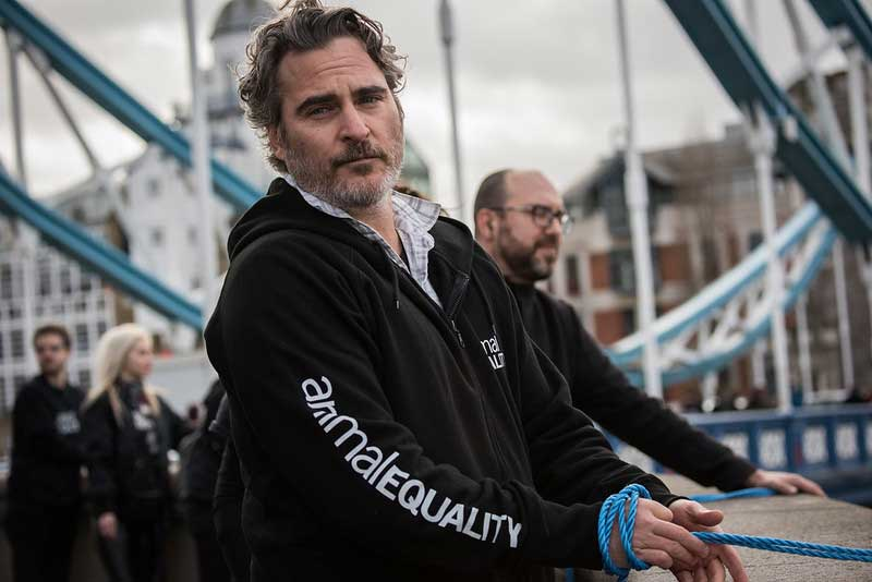Joaquin Phoenix says 'go vegan' and ties himself to London's Tower Bridge during animal rights protest