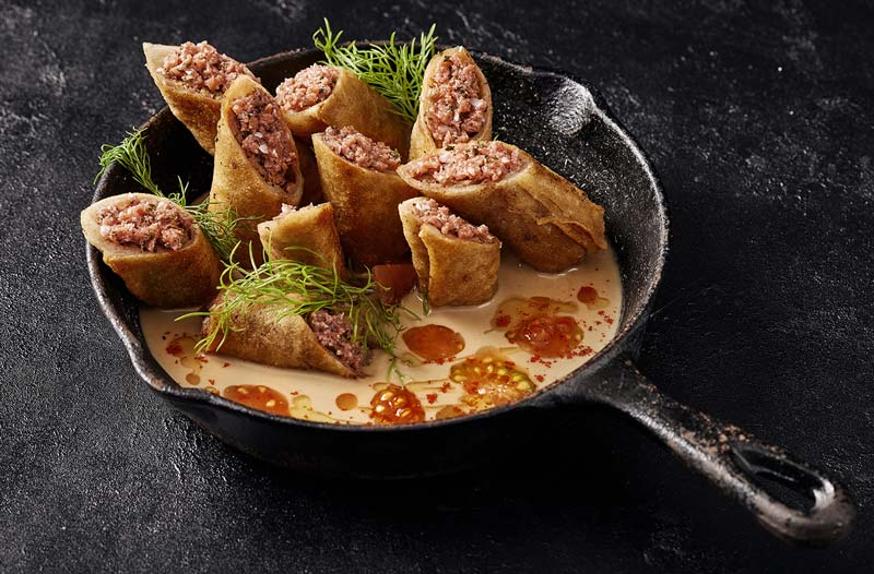 Redefine Cigar, vegan ground beef wrapped in a crispy filo pastry.