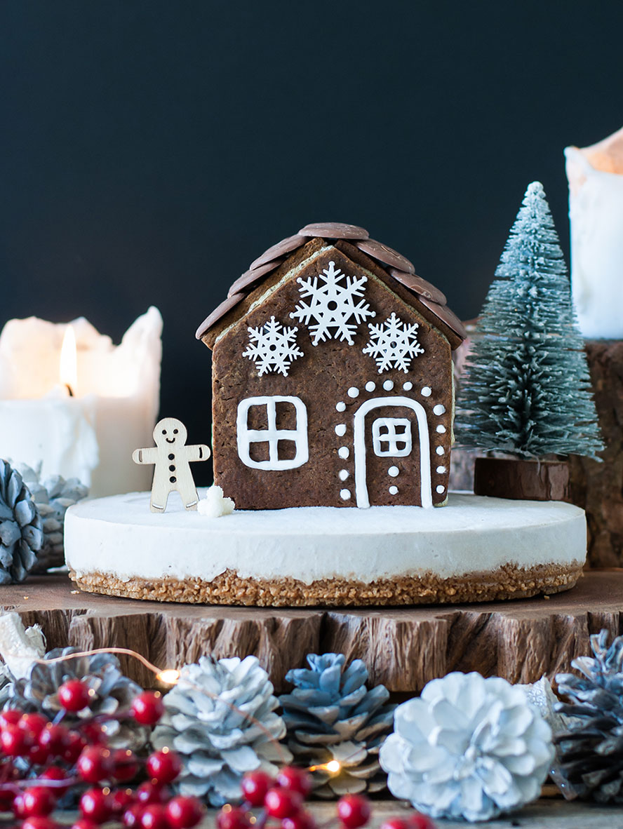 Vegan Gingerbread Cheesecake with a Gingerbread House Topper