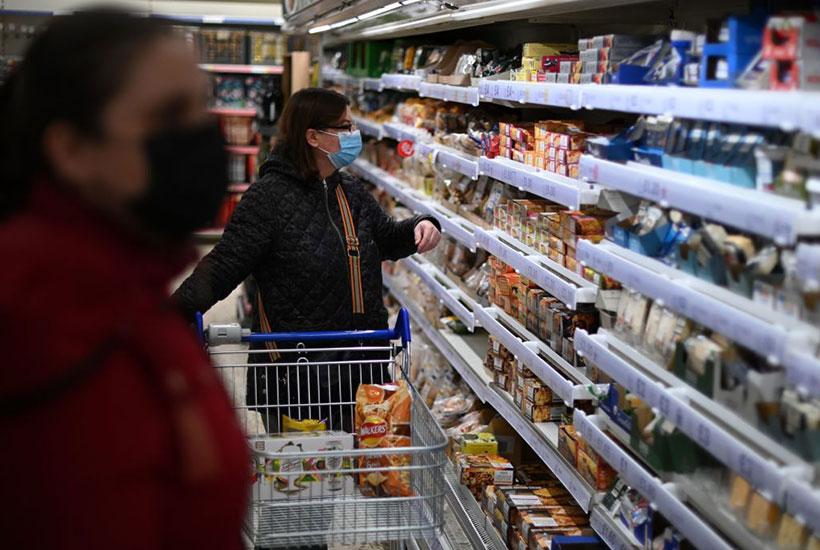 woman shopping vegan in meat aisle